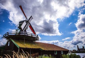 Dutch windmills with dramatic cloudy sky..