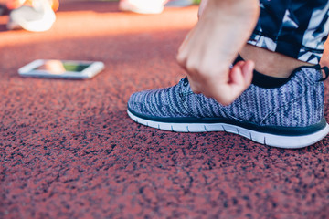 Woman runner tying shoelaces