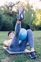 Happy woman doing pilates exercise for legs