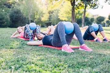 Beautiful women doing pilates