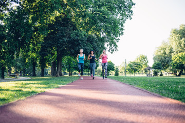 Beautiful young women running on a jogging track