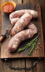 Raw pork sausages with herbs and spices
