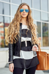 Style blonde girl with bag outdoor