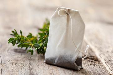 tea bag and fresh thyme