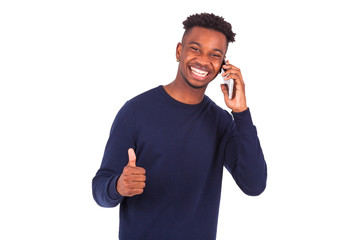Young African American man holding a smartphonemaking thumbs up