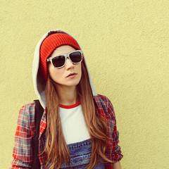 Brunette Student. Fashion autumn time. Checkered shirt. Urban st