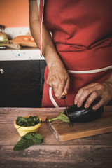 unrecognizable Woman cutting vegetables
