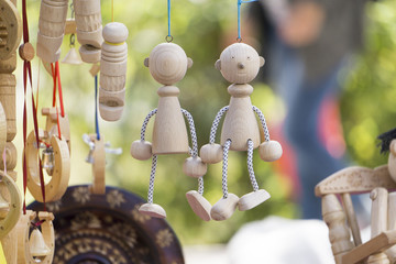 2 wooden toy in the form of a man on a string back to back