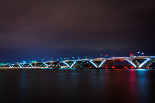The Woodrow Wilson Bridge and Potomac River at night, seen from