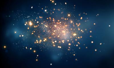 fire sparkles in dark blue bokeh background