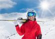 A female skier on the piste.