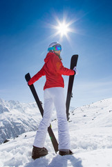 A female skier on the piste.