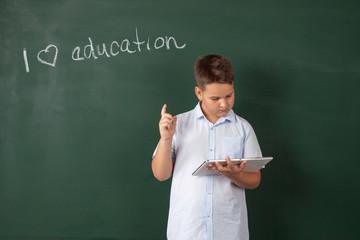 boy in a shirt with school boards
