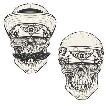 Set of the human skulls in bandana and cap. Gangster skull.  Des
