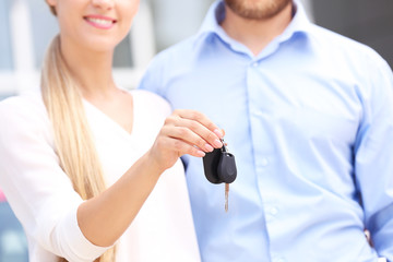 Young couple with car key