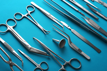 Flat lay of medical instruments on blue background