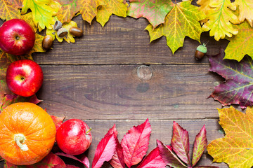 happy thanksgiving autumn background with pumpkin, apple and colorful leaves