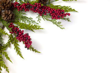Christmas Garland with Pine Cones and Berries isolated on white