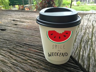 Smile weekend word and watermelon on coffee cup