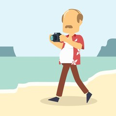 guy walking on beach with camera