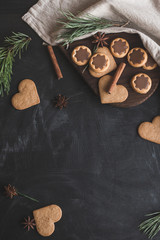 Christmas composition. Christmas gingerbread, pine branch, cinnamon sticks, anise star. Flat lay, top view