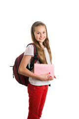 A schoolgirl with book and backpack is posing in studio