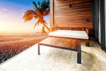 Retouch daybed with morning beach view