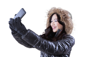 Girl taking a selfie with her mobile