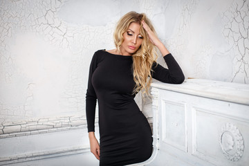Beautiful woman with slim body in a black dress