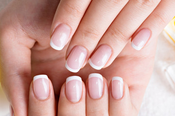 Foto op Canvas Manicure Woman in a nail salon receiving manicure