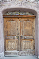 Old closed wooden door with stone frame