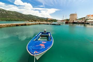 Blue boat in the port in Mali Ston in Croatia
