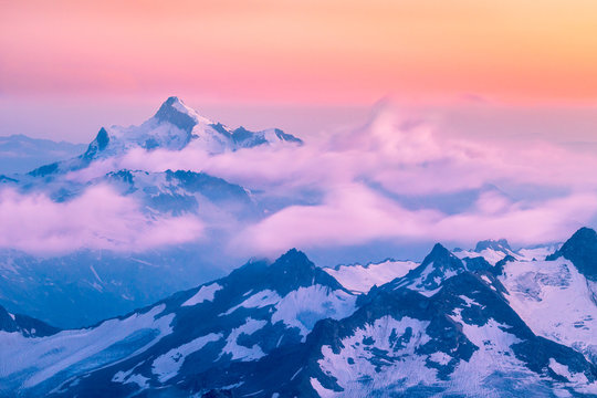 Mountains and moving clouds at sunset