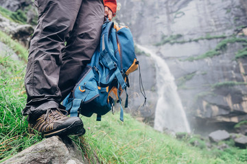 Taveler legs in wet outoor shoes hear the  Jogini waterfall
