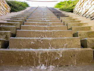 Water flowing down the stairs (close view).