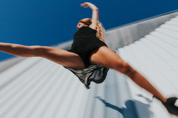 Dancer performing a big jump. Motion sensation.