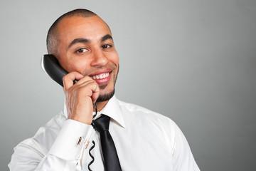 happy businessman talking on landline phone