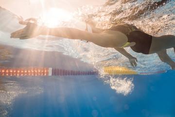 Swimmer in back crawl style underwater