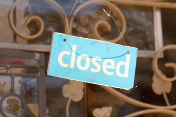 Closed sign in shop doorway