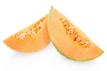 Cantaloupe melon slices with seeds on white, clipping path