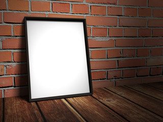 Blank picture frame on red brick wall