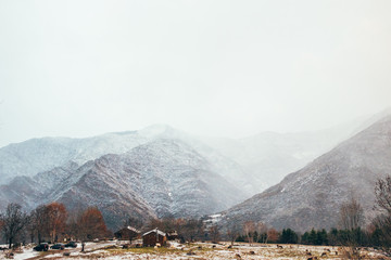 Picturesque view of winter village in mountains