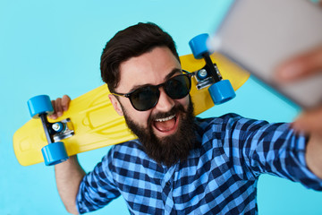 young bearded hipster man makes a selfie