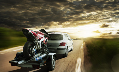 Race Motorbike On Trailer Behind Car