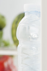 Bottles with water in refrigerator