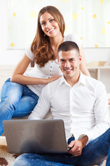 Young couple surfing and shopping online.