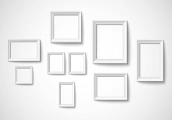 Blank art frame set isolated on wall Vector