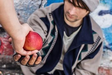 Homeless man getting food