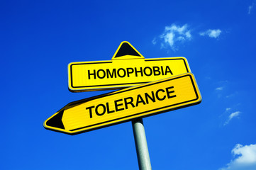 Homophobia vs Tolerance - Traffic sign with two options - Appeal to be tolerant and accept homosexuality as normal sexual orientation. Negative preconception vs respect and acceptance
