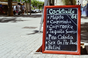 chalkboard with a list of cocktails in Barcelona, Spain